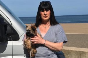Dog walker says she 'felt like a criminal' as cops pulled her over for driving five miles to the beach