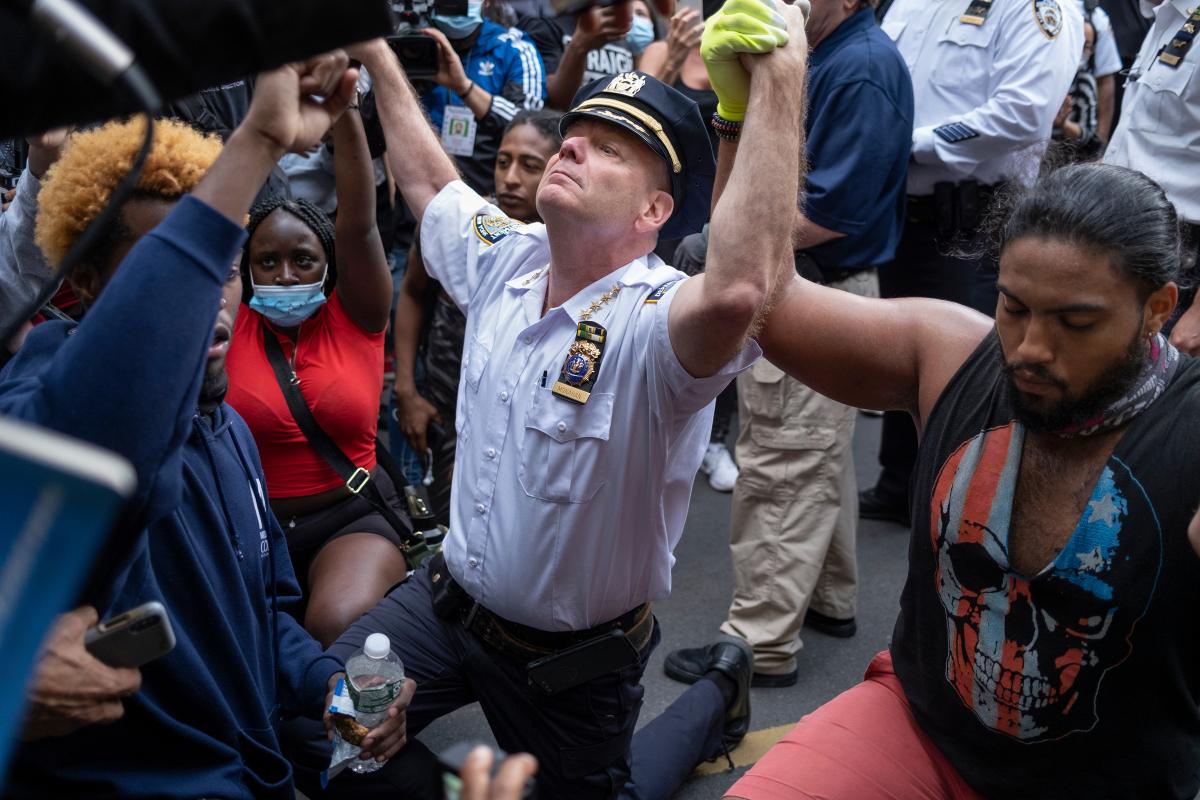 NYPD chief kneels with George Floyd protesters after telling them Minnesota killing 'was wrong' but rioting must stop